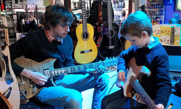 Guitar lesson during last year's Learn To Play Day