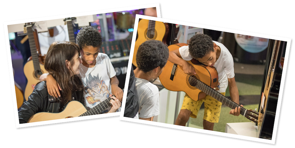 Students learning guitar on Learn To Play Day 2017
