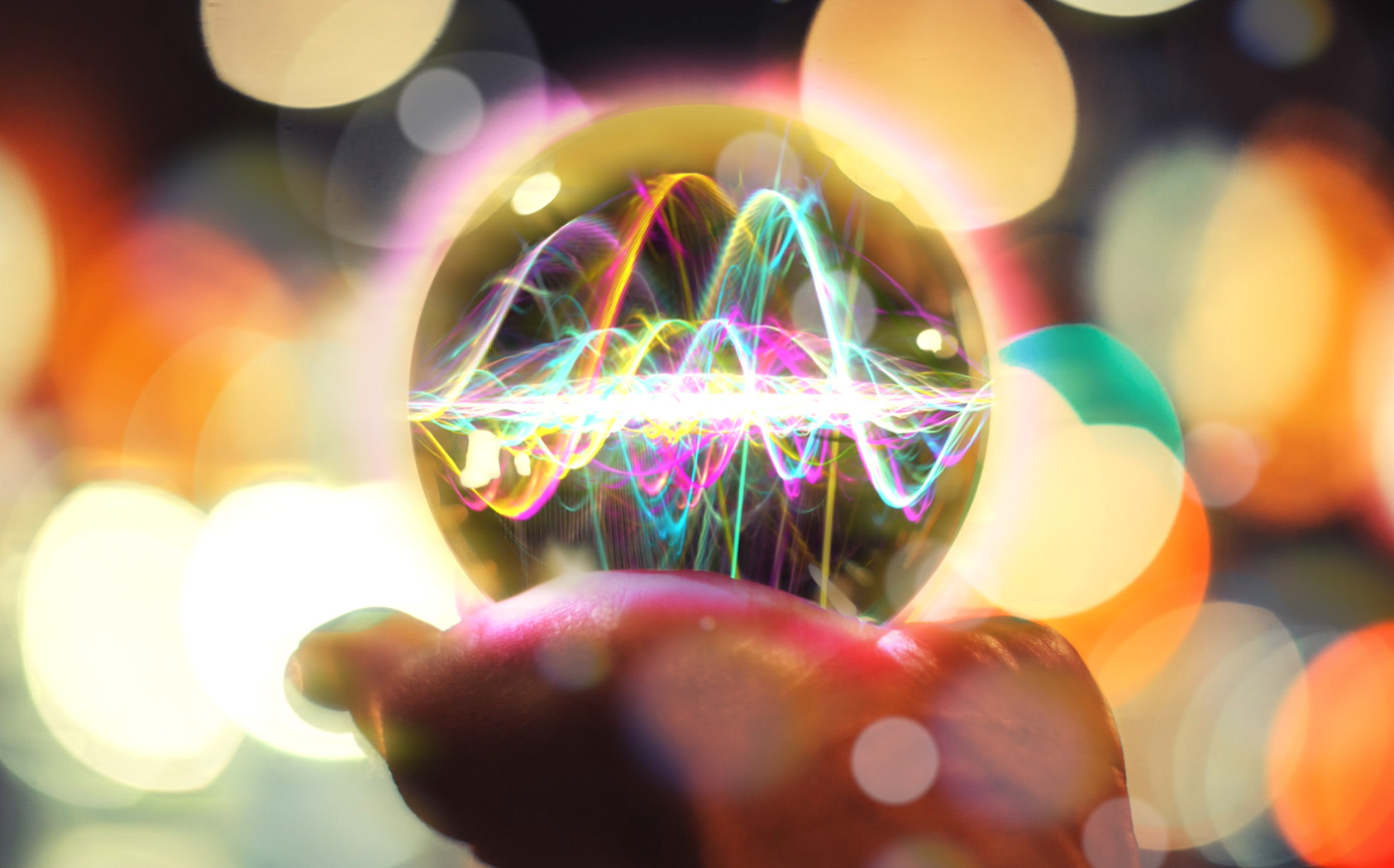 Image of a woman holding a crystal ball with sound waves visible
