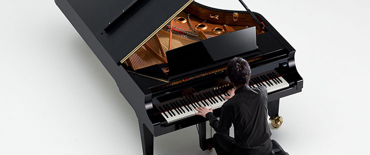 Pianist playing a Yamaha CF Series Concert Grand Piano
