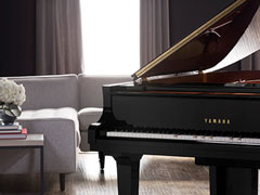 Photo of a Disklavier Enspire Pro in a living room